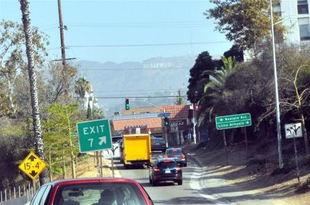 Far in the smoggy distance is the HOLLYWOOD sign. Oh wow.
